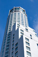 white business tower over blue sky