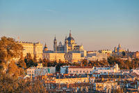 Madrid Spain, sunset city skyline at Cathedral de la Almudena with autumn foliage season