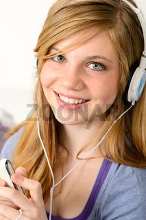 Portrait of a teenage girl listening music