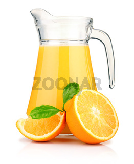Jug of orange juice and orange fruits with green leaves