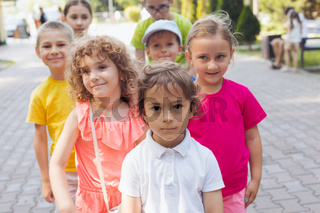 Adorable preschoolers at city park, group photo