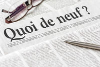 A newspaper with the headline What is new in french - Quoi de neuf