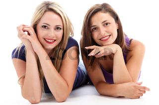 Cheerful women relaxing on the floor