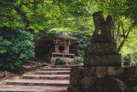 Small shrine along stairs path in park on Mount Misen in Miyajima, Hiroshima, Japan