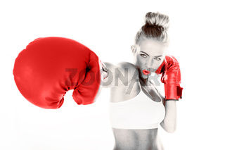 Sexy woman delivering a punch