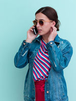 Portrait of young girl talking on the phone