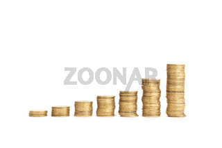 Rising Coin stacks on a white background. Growth, income, savings, investment concept. Symbol of wealth