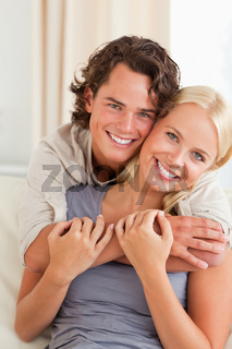 Portrait of a young couple embracing each other