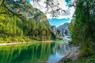 Tranquil green waters of Lake Prags in the italian Dolomites