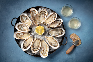 Oysters with white wine and a shucking knife