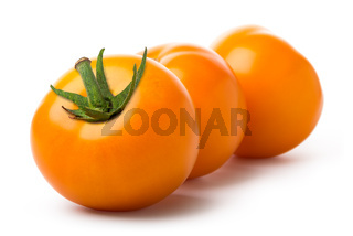 Three yellow tomatoes