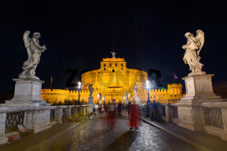 Night view of Castel Sant'Angelo and Ponte Sant'Angelo in Rome, Italy