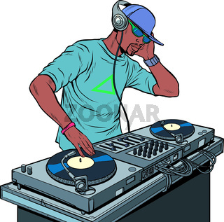 Black man dj on vinyl turntables. concert music performance
