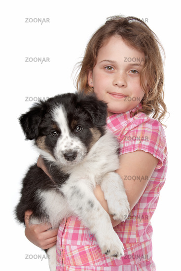 Girl and border collie puppy