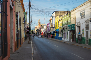 Local street life in Mexican colonial city of Merida, Mexico
