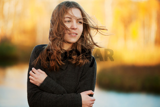 Young girl in an autumn park