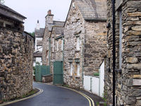 narrow street of old houses in the village of cartmel in cumbria