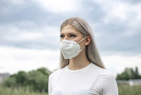 young blond woman with mask