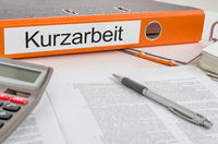 Folder with the label Short-time-work in german - Kurzarbeit