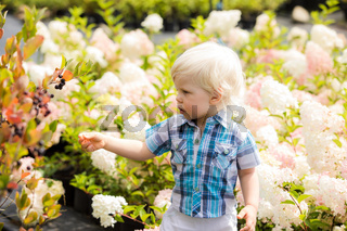 Cute blonde boy outdoor at botanical garden