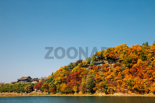 Yeongnamnu Korean traditional pavilion and autumn colorful mountain in Miryang, Korea