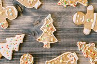 Gingerbread Christmas cookies on a wooden texture.