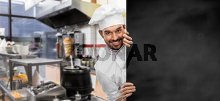 happy smiling male chef with big black chalkboard