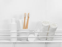 Personal care and hygiene toiletries in white bath