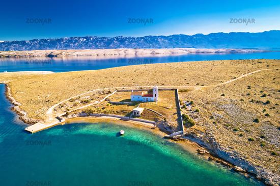 Stone desert island of Zecevo church and pilgrimage aerial view