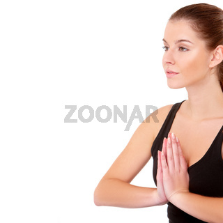Portrait of pretty young woman doing yoga