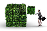 Businesswoman in green environment concept