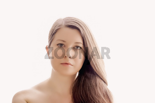 Beautiful woman with natural look, perfect skin and shiny hair as make-up, health and wellness concept. Face portrait of young female model for skincare cosmetics and luxury beauty ad design