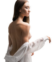 Slim woman topless rearview undress shirt isolated