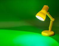 Desk lamp on green
