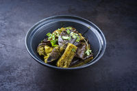Traditional Indian eggplant curry fry served as side dish in a design bowl
