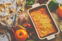 Tasty traditional italian lasagna with bolognese, melted and cheese. Served with ingredients