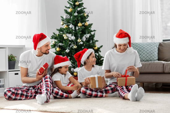happy family opening christmas gifts at home