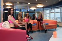 Pretty girls posing in recreation room at gym