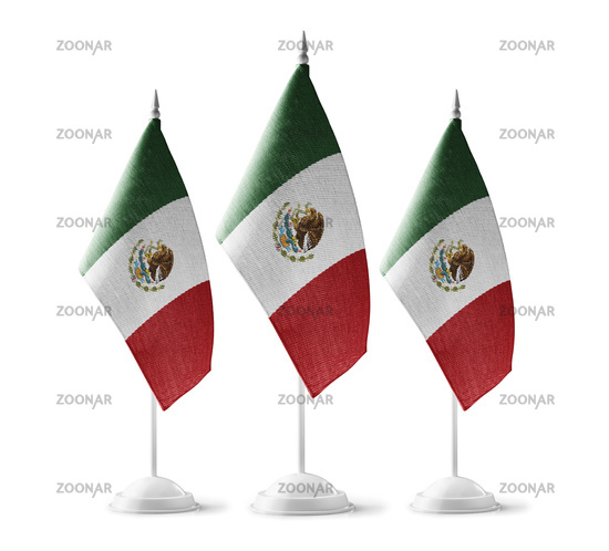Small national flags of the Mexico on a white background