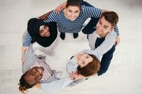 top view of diverse group of people standing embracing and symbolizing togetherness
