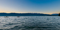 Idyllic calm soothing morning scenery at mountain lake Walchensee in Bavaria, Germany at dawn with fishing row boats