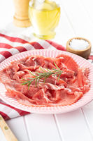 Sliced carpaccio. Raw beef meat.