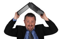 Man lifting computer over his head