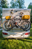 Two bicycles on a caravan. Family vacation travel RV, holiday trip in motorhome