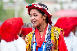 Tibetan girl performing folk dance