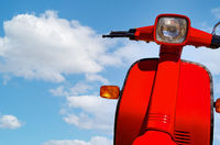 Motorcycle motorcycle on blue sky background. Classic scooter against blue cloud sky in summer