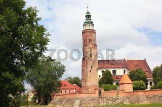 Church behind defence city wall with tower in Wschowa Poland