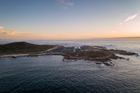 Amazing drone aerial landscape view of a Sea fishing farm on land at sunset in Galiza, Spain