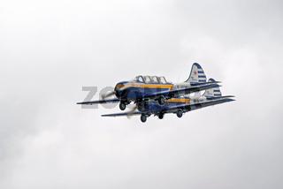 Two Yak-52 planes fly in formation