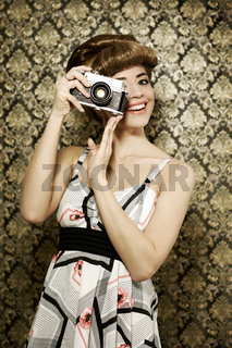 Pin up girl with retro camera